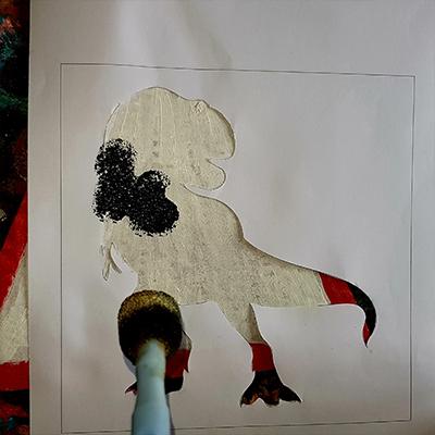 pochoir dinosaure à la peinture noire